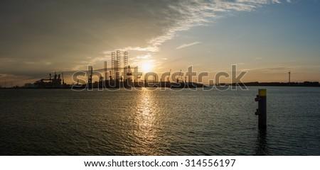 Panorama sunset port of Rotterdam - stock photo