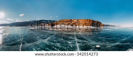 Panorama very cool pure ice of the frozen lake with clean fresh. The Lake Baikal. - stock photo