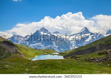 Panorama view of Bachalpsee and the snow coverd peaks including Schreckhorn, Wetterhorn with glacier of swiss alps, on Bernese Oberland, Switzerland. - stock photo