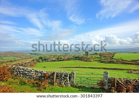 Panorama view of Bodmin Moor, the ruins of a Cornish Tin Mine, the Phoenix United Mines Prince of Wales Engine House can be seen in the distance, near Minions on Bodmin Moor, Cornwall, United Kingdom - stock photo