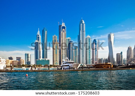 "Panorama view of Dubai skyscrapers in UAE. Dubai Marina is called ""Manhattan"" of Dubai. Dubai Marina is a prestigious residential area of Dubai close to the sea  - stock photo"