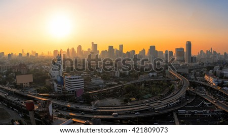 Panorama view of modern office buildings, condominium and skyscraper tower in big city downtown with sunset sky - stock photo