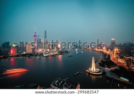 Panorama view of Shanghai city scape at night time. Aerial view shanghai city skyline night, shanghai city river, shanghai city skyline boat, shanghai city skyline lights, city night, city light - stock photo