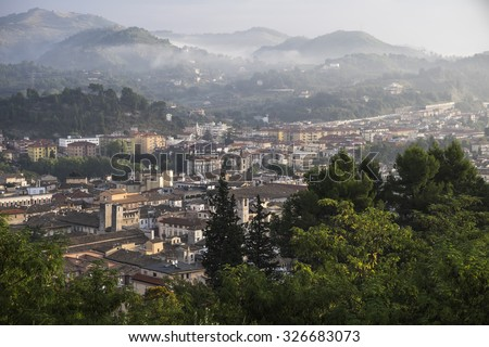 Panorama view on Ascoli Piceno (Marche, Italy) in early morning with mist in the hills - stock photo