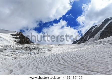 Panorama view on the Tre-la-Tete glacier in French Alps, near the Domes-de-Miage towards Mont Blanc, France. - stock photo