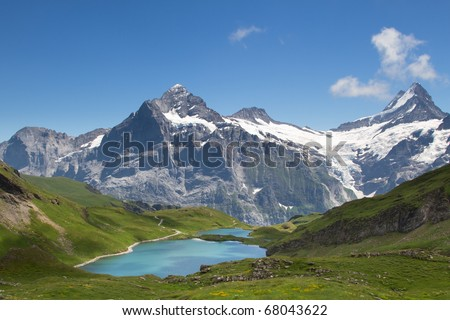 Panorama view towards the Bachsee and the Wetterhorn and the Schreckhorn in the Swiss Alps. - stock photo