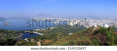 panorama with lake and palaces in Udaipur India - stock photo
