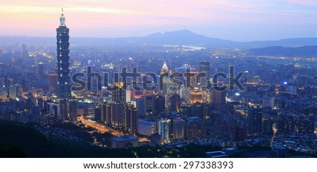 Panoramic aerial view of busy  Taipei City,  Taipei 101, Tamsui River  and downtown area at dusk ~ A Blue and Gloomy evening in Taipei ~  - stock photo