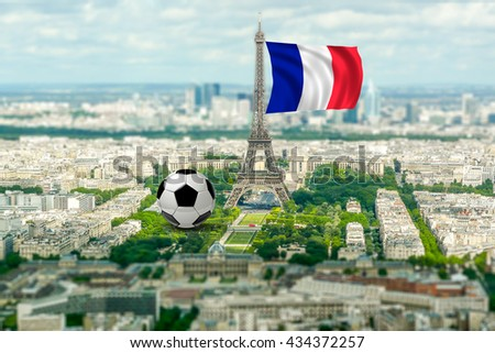 Panoramic aerial view of Paris from Tour Montparnasse. Tilt-shift effect applied and composition with giant soccer ball and french flag. Concept for football championship - stock photo