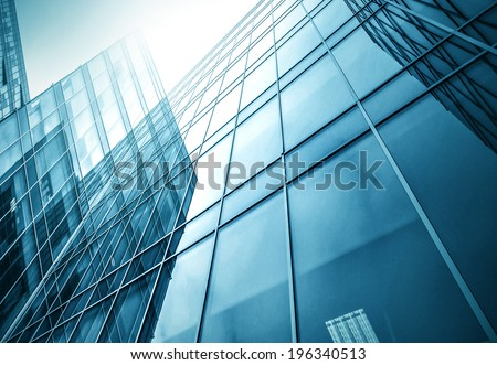 Panoramic and perspective wide angle view to steel light blue background of glass high rise building skyscraper commercial modern city of future. Business concept of successful industrial architecture - stock photo