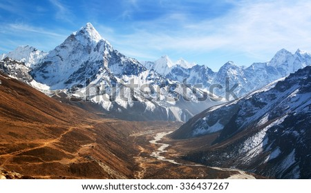 Panoramic beautiful view of mount Ama Dablam with beautiful sky on the way to Everest base camp, Khumbu valley, Sagarmatha national park, Everest area, Nepal - stock photo