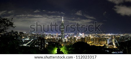 Panoramic city view at night inTaipei, Taiwan after the summer storm - stock photo