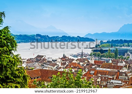 Panoramic cityscape of Lucerne and lake in foggy weather - stock photo