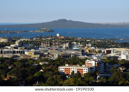 panoramic, clear blue sky day view of Auckland's island volcano: rangitoto.  shot from mt eden with newmarket in foreground - stock photo