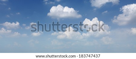 Panoramic cloudscape of a blue cloudy sky.  - stock photo