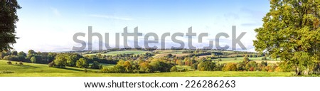 Panoramic Cotswold View, Gloucestershire, England taken below Stow on the Wold on a bright autumn morning - stock photo