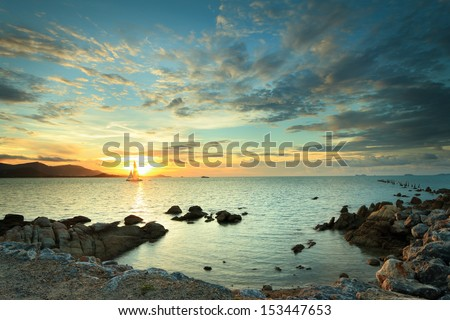 Panoramic dramatic tropical sunset sky and sea at dusk - stock photo
