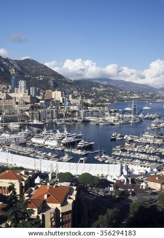 panoramic harbor view Monte Carlo Monaco Europe with yachts sailboats condos - stock photo