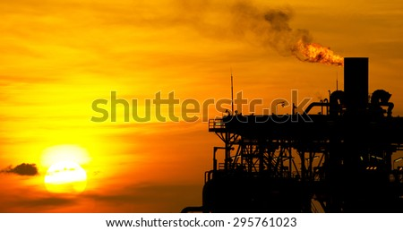 Panoramic image of a Gas or flare burn on an offshore oil-rig - stock photo