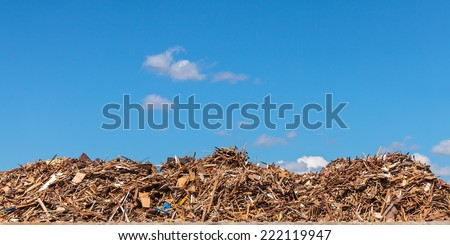 Panoramic image of a large pile of wood on a garbage depot - stock photo