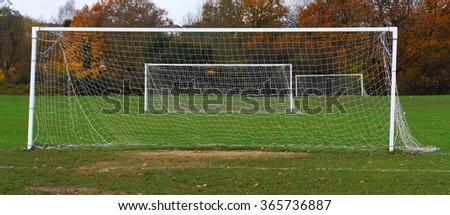 Panoramic image of football playground with three goalposts - stock photo
