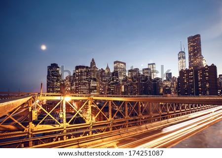 Panoramic image of lower Manhattan skyline taken from Brooklyn Bridge - stock photo