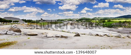 Panoramic image of rock quarry - stock photo