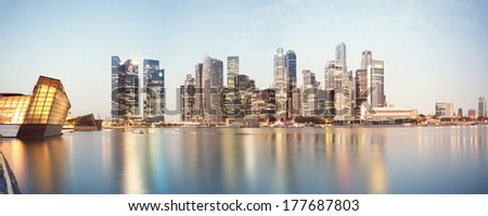 Panoramic image of Singapore`s business district at night.  - stock photo