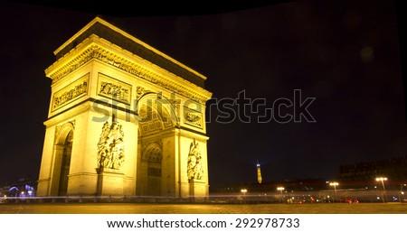 Panoramic image of the famous Arc de Triumph at night, Paris, France - stock photo