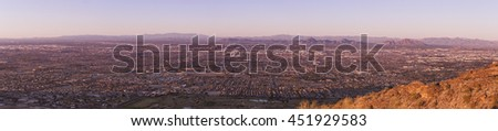 Panoramic image of The Valley of the Sun, Phoenix metropolitan area. Phoenix is the capitol of Arizona, USA, and it's downtown is visible in the middle section of the image. - stock photo