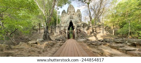 Panoramic image of the west gate of Angkor Thom, Angkor Wat, Cambodia - stock photo