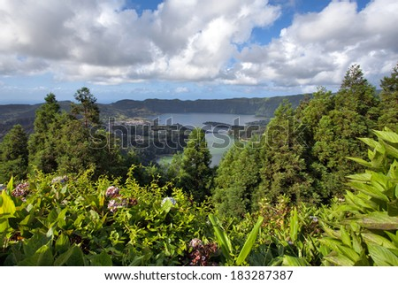 Panoramic landscape of the Lagoa das Sete Cidades on the island of S�£o Miguel. Azores is an archipelago of volcanic islands and an amazing tourist destination. - stock photo