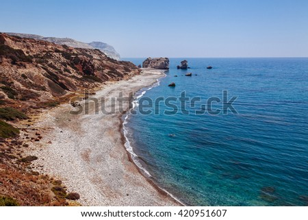 Panoramic landscape Petra tou Romiou (The rock of the Greek), Aphrodite's legendary birthplace in Paphos, Cyprus island, Mediterranean Sea. Amazing blue green sea and sunny day. - stock photo