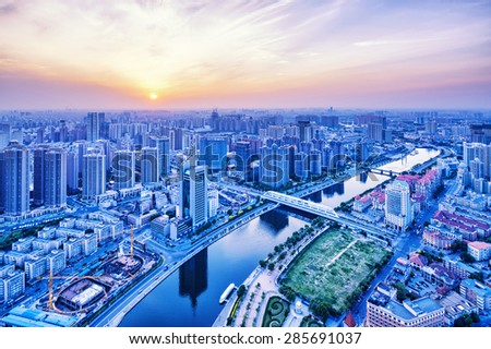 Panoramic modern skyline and buildings during sunset - stock photo