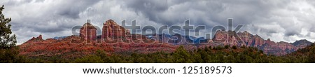 Panoramic of Cathedral Rock in Coconino National Forest in Arizona on a stormy  day. - stock photo