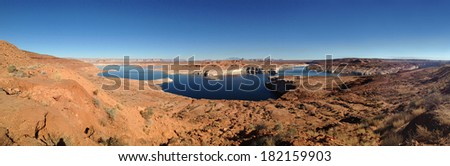 panoramic of desolate eroded rock landscape surrounding waters of lake mead, page, arizona - stock photo
