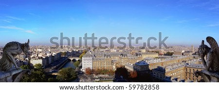 Panoramic of Paris (France) with Gargoyles architectural fragment in foreground, taken from the roof of Cathedral Notre Dame (Stitched Panorama) - stock photo