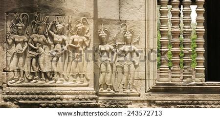 Panoramic of Stone Devata Sculptures At Angkor Wat Temple, Cambodia - stock photo