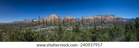 Panoramic of the city of Sedona Arizona along with the surrounding  mountains and Oak Creek Canyon. - stock photo