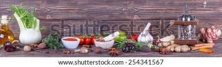 Panoramic of vegetables and spices on wooden background - stock photo