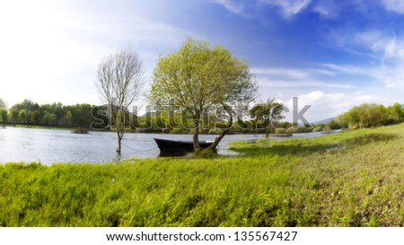 Panoramic Photo of a Boat in Ponte de Lima, Portugal - stock photo