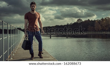 Panoramic photo of handsome man and nature as background - stock photo
