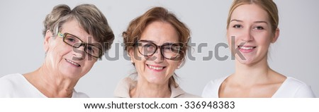 Panoramic photo of smiling beautiful family women together - stock photo