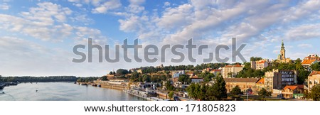 Panoramic photograph of Belgrade waterfront, with Kalemegdan park, Belgrade medieval fortress, St. Michael's Cathedral bell tower, Tourist nautical port, and Belgrade downtown skyline.  - stock photo