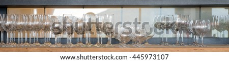 Panoramic picture of empty glasses on the shelf - stock photo