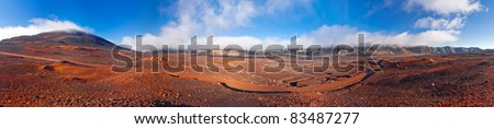 Panoramic scenic view of road on volcanic landscape of the Plaine des Sables, Reunion Island. - stock photo