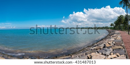 Panoramic scenic view of the beach sidewalk along the coast of Negara with Java Island in the background. Indonesia - stock photo