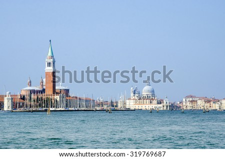 Panoramic sea view of the San Giorgio Maggiore island and basilica Santa Maria della Salute in Venice, Italy. - stock photo