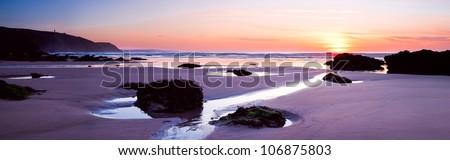 Panoramic shot of sunset on Porthtowan Beach, Cornwall - stock photo