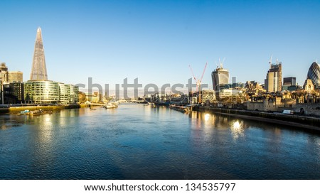 Panoramic shot of the river thames at sunrise - stock photo